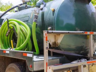 septic pumping truck emptying tank in Louisville